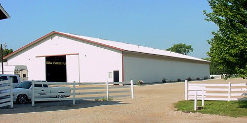 West of the barn lies the indoor equestrian work arena...